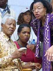 Gayle King, in background wearing hat, said one of the coolest things she has done in her life was visiting Nelson Mandela's house in South Africa.