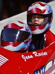 Gea Johnson, back, of Phoenix and driver Jean Racine