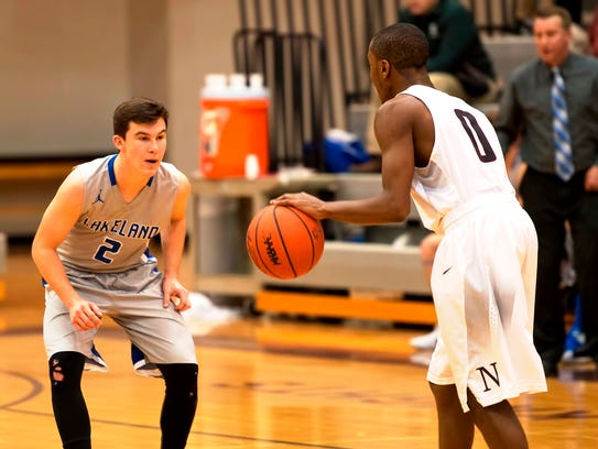 Walled Lake Northern guard Jalen Kelso (right) probes