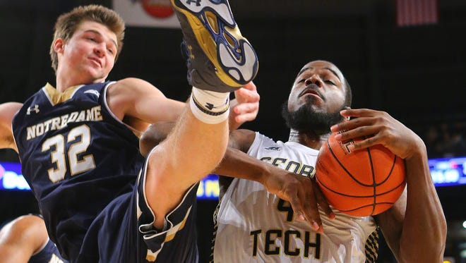 Georgia Tech's Demarco Cox battled Notre Dame's Steve Vasturia (32) for a rebound during a game this month.