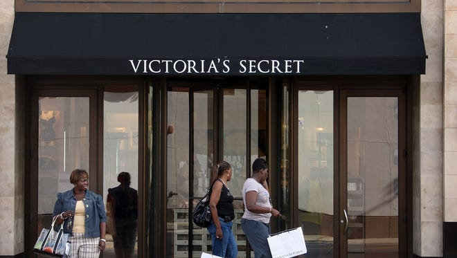 Shoppers walk past a Victoria's Secret store in Chicago.