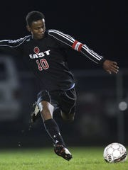 Green Bay East's Osman Abdi (10) switches the field