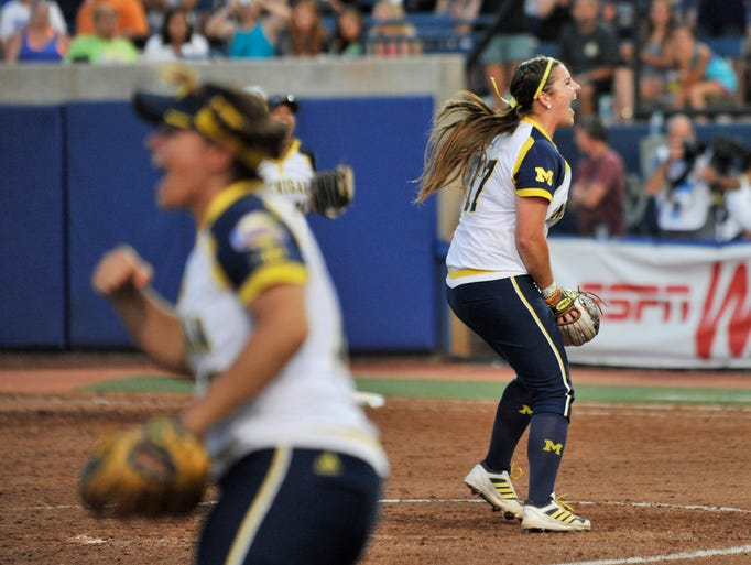 Michigan pitcher Haylie Wagner, right, reacts after