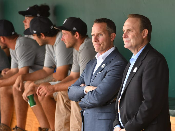 Chris Ilitch stands with Duane McLean, Tigers executive