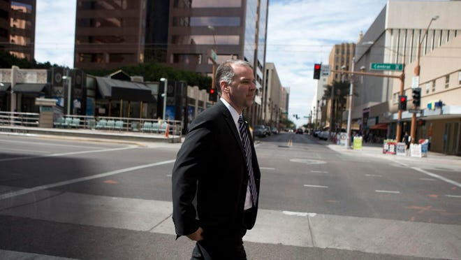 Phoenix's new city manager, Ed Zuercher, heads to a recent meeting at the Greater Phoenix Chamber of Commerce <137,2014/03/09,McDonnall/c John Paul1>in<137> downtown.