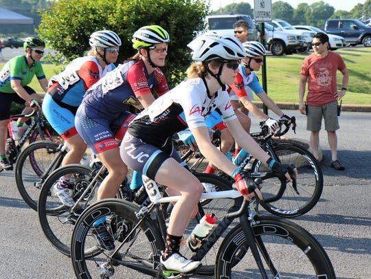 The women cyclists began the 66-mile Road Race at Trinity