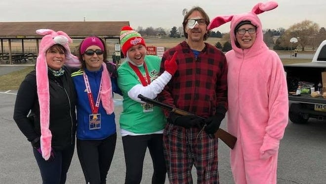 Franklin County runners came together at Norlo Park on Friday to celebrate six years of run-streaking — running at least one mile every day — for Chambersburg's Laurie Dymond and Mont Alto's Angie Fuss. Pictured, from left to right, are Deb Swope, Dymond, Fuss, Mitch Hawbaker and Denise Metzger.
