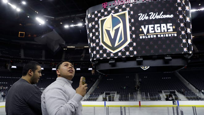 People tour T-Mobile Arena during an event to unveil the name of Las Vegas' National Hockey League franchise, Tuesday, Nov. 22, 2016, in Las Vegas. The team will be called the Vegas Golden Knights.