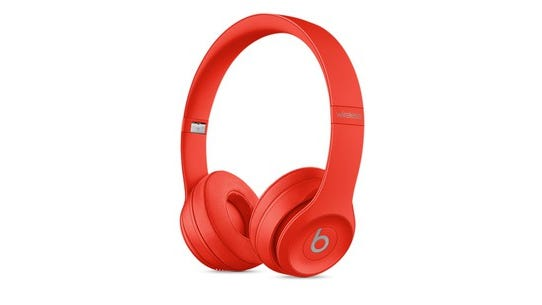 Red Beats headphones against a white background.