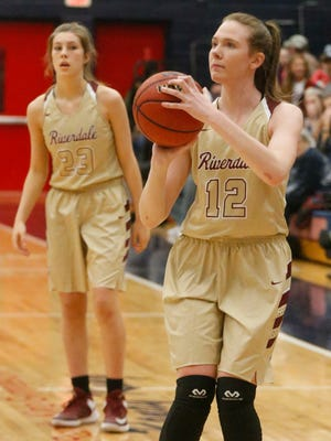 Amanda Whittington (12), Jalyn Holcomb (23) and the Riverdale girls basketball team are ranked No. 2 in the first Associated Press Class AAA poll.