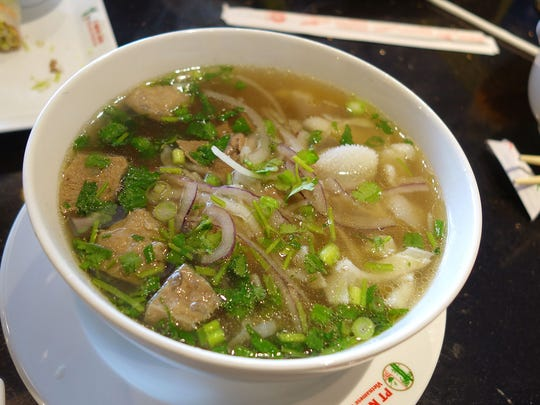 Pho dac biet (rice noodle and beef soup with steak,