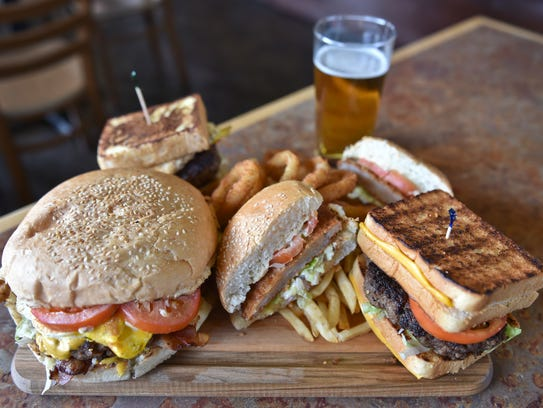 Hand-crafted burgers of all shapes and sizes are presented
