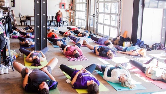 Disko Lemonade holds a yoga class at Perfect Plain Brewing Co. on Jan. 27, 2018.