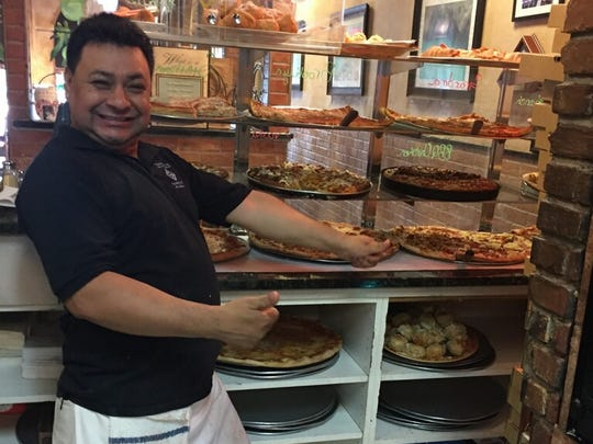 Pizza chef Rosendo serves up a range of freshly-made pies at 50 year-old Edison Pizza.