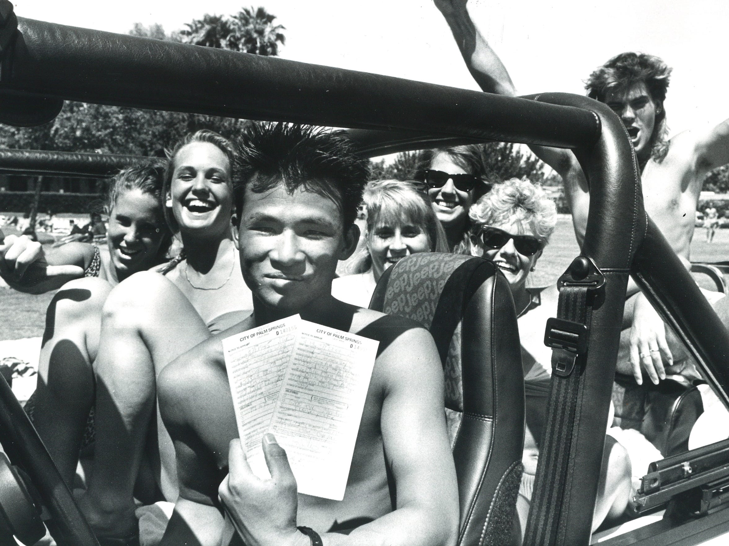 A spring breaker shows off a citation he received from Palm Springs police in 1987, when the city tried to quell the party with excessive ticketing.