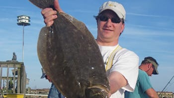 """File photo: Dan Chesla of Franklinville, NJ checked in with a 5 pound Flounder caught while drifting Mackerel Strips on Lou Santoro's boat """"Late Bite"""" out of Wildwood, NJ."""