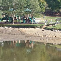 Lake Louise in Weaverville was partially drained in anticipation of heavy rains.
