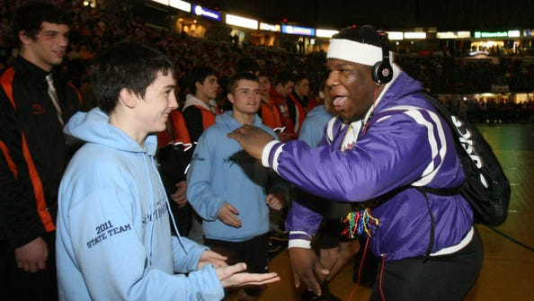 Somers' Dylan Realbuto, left, and New Rochelle's Malcolm Allen get ready for their championship round matches at the NYSPHSAA Wrestling Championships at the Times Union Center in Albany Feb. 26, 2011.