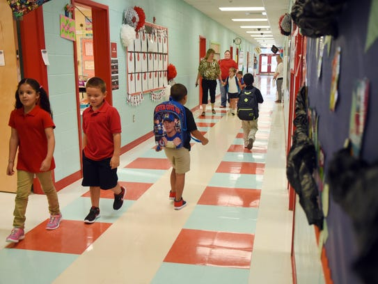 Petal Primary students walk through the hallway for