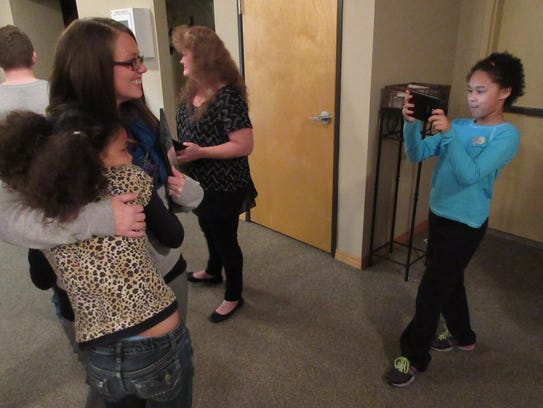 Alison Eley's daughter Hannah, 11, takes a photo of