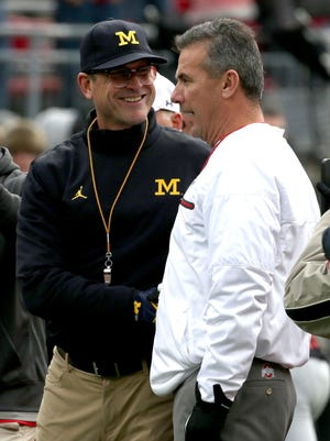 Jim Harbaugh's Michigan and Urban Meyer's Ohio State will battle for a third time on Saturday.