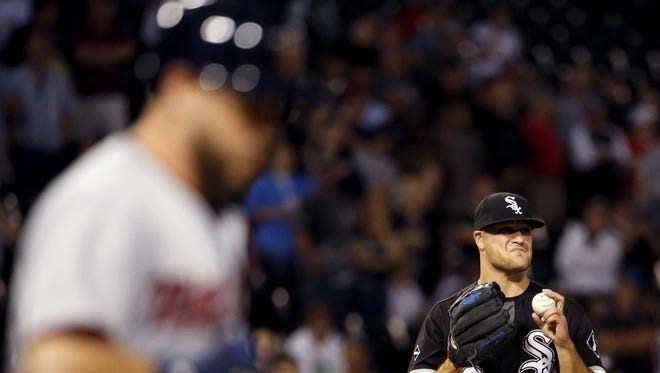 Chicago White Sox relief pitcher Dan Jennings, right, reacts as the Minnesota Twins' Trevor Plouffe walks to first base during the ninth inning Wednesday in Chicago.