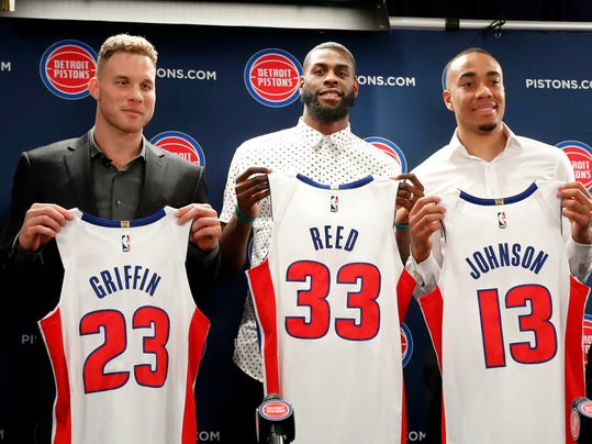 Detroit Pistons' Blake Griffin, from left, Willie Reed and Brice Johnson pose with their new NBA basketball uniforms in Auburn Hills, Mich., Wednesday, Jan. 31, 2018. (AP Photo/Paul Sancya)