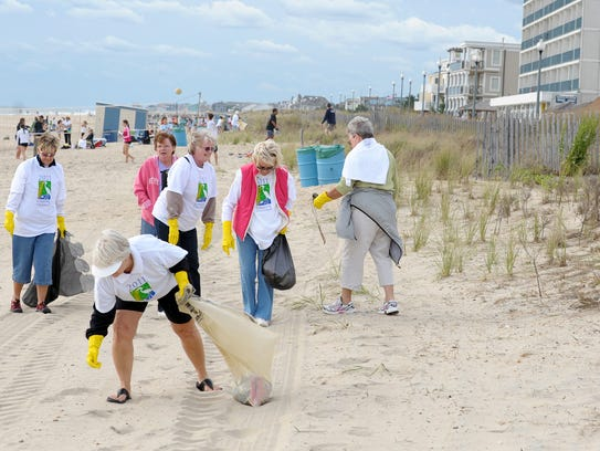 Volunteers help clean up the beach at Rehoboth Beach