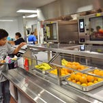 The front of the newly renovated kitchen at Oconto Middle School can be seen as a student stops to get syrup for his French toast sticks. The project was completed just before school started.