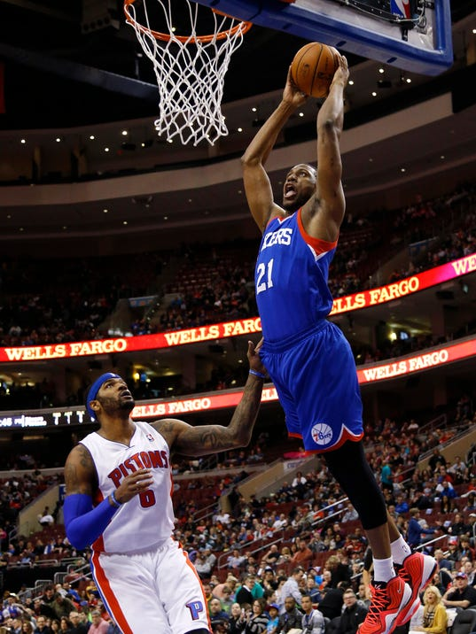 Philadelphia 76ers' Thaddeus Young, right, goes up for a dunk against Detroit Pistons' Josh Smith during the first half of an NBA basketball game on Saturday, March 29, 2014, in Philadelphia. (AP Photo/Matt Slocum)
