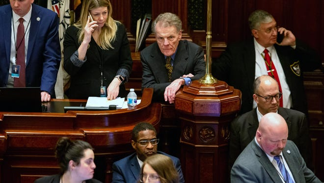 """Illinois Speaker of the House Michael Madigan, D-Chicago, listens to debate on the fiscal year 2020 budget on the floor of the Illinois House late into the evening on the scheduled last day of the Spring Session at the Illinois State Capitol, Friday, May 31, 2019, in Springfield, Ill. In court documents filed Friday where ComEd agreed to pay $200 million to resolve a federal investigation into a """"years long bribery scheme,"""" federal prosecutors identify a Public Official A who they said was Speaker of the House of Representatives. There was no mention of charges against Public Official A in the documents."""
