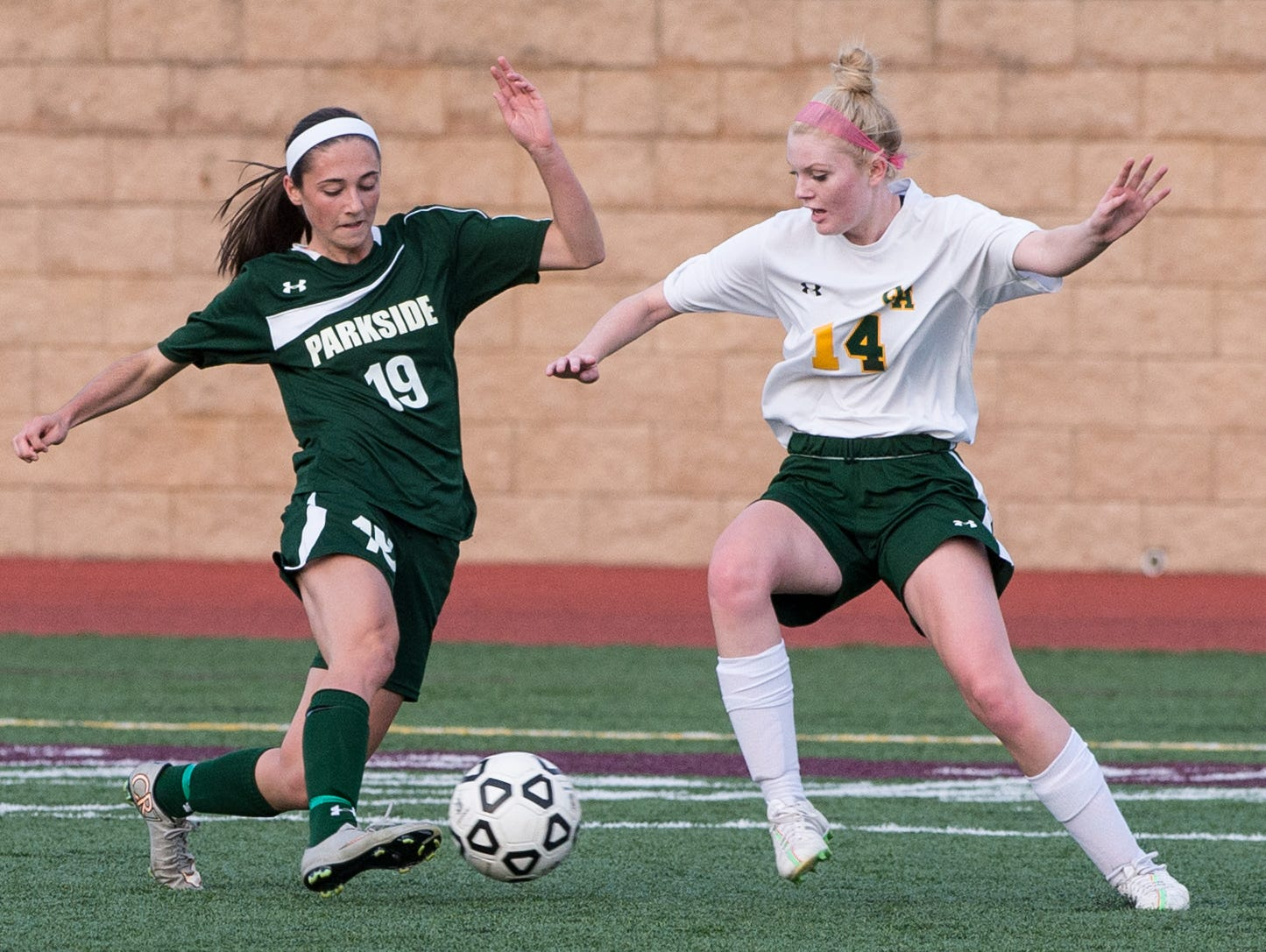 Parkside's Blair Vilov (19) attempts to move the ball around Queen Anne's Meagan Lukehart (14) in the Bayside Championship at Washington College in Chestertown on Monday, October 26th.