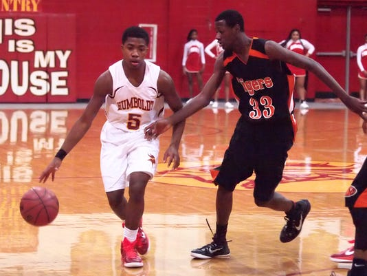 2 Jarred Walker #5 Humboldt dribbles the ball against MIddleton's #33 Tyland.JPG