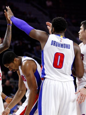 Pistons center Andre Drummond (0) high fives guard Kentavious Caldwell-Pope (5) after a basket against the Pacers during the first quarter of the preseason game at The Palace of Auburn Hills on Oct. 6.