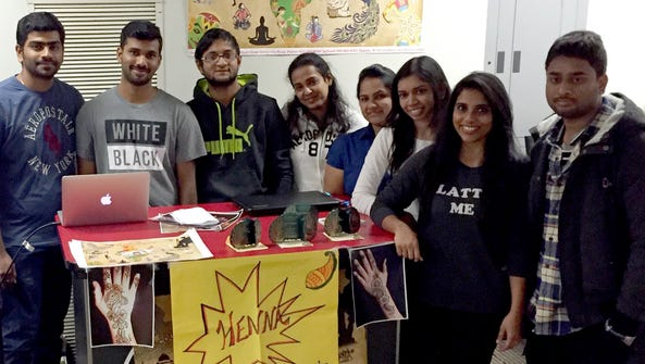 Members of the India Heritage Club sell tickets for
