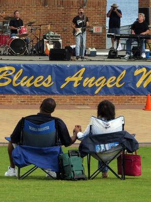 """In this file photo, the band Reddog & Friends entertains the crowd at Community Maritime Park as part of the Blues Angel Music's """"Blues on the Bay"""" concert series."""