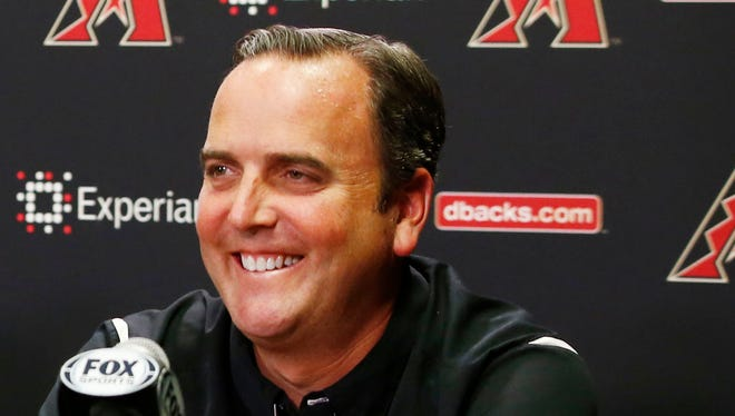 Derrick Hall, (right) president of the Arizona Diamondbacks, introduces De Jon Watson, (left) as their new senior VP of baseball operations and Dave Stewart as the new GM during a press conference on Friday, Sept. 26, 2014 at Chase field in Phoenix, AZ.