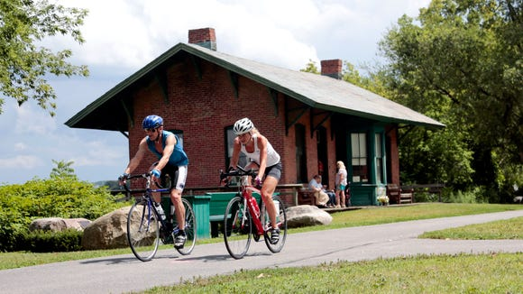 FILE- In this Tuesday, Aug. 4, 2015 file photo, cyclists