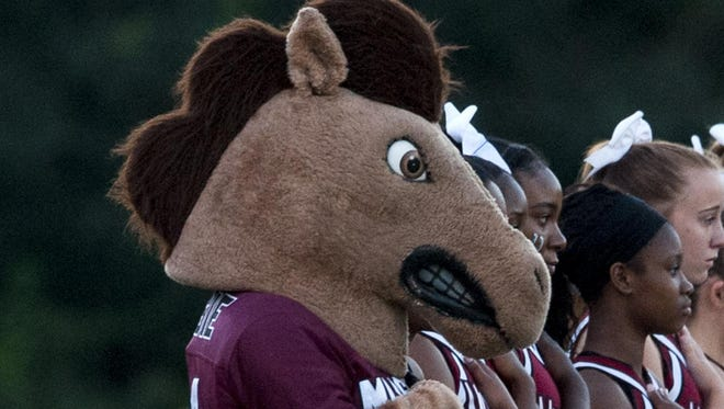 Stanhope Elmore cheerleaders and mascot stand for the National Anthem in Millbrook, Ala. on Friday September 18, 2015.