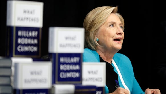 """Hillary Clinton signs copies of her new book, """"What"""