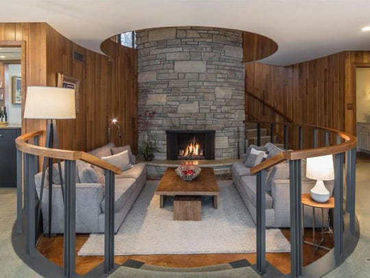 The conversation space and two-story fireplace inside