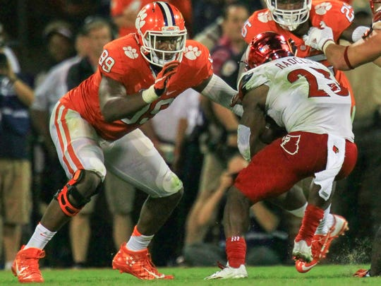 Clemson defensive end Clelin Ferrell (99) gets ready to tackle Louisville running back Brandon Radcliff(23) during the fourth quarter on Saturday October 1 at Memorial Stadium in Clemson.