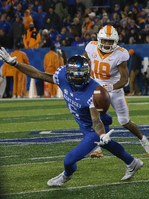 University of Kentucky's Lonnie Johnson Jr. reaches for the ball in an attempt at an interception, during Saturday nights's game against Tennessee.