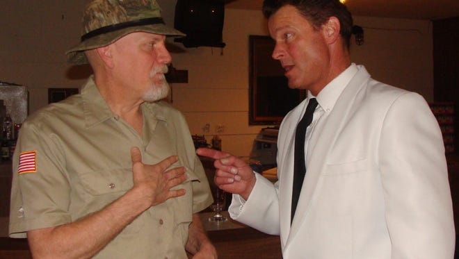 "Casino owner Rick, played by Stuart Champeau, right, in discussion with Croc Chaser (Dan Sallinen) in a scene from the Rogue Theater production of ""Dealt a Deadly Hand: Murder at the Pocono Royale Casino."""