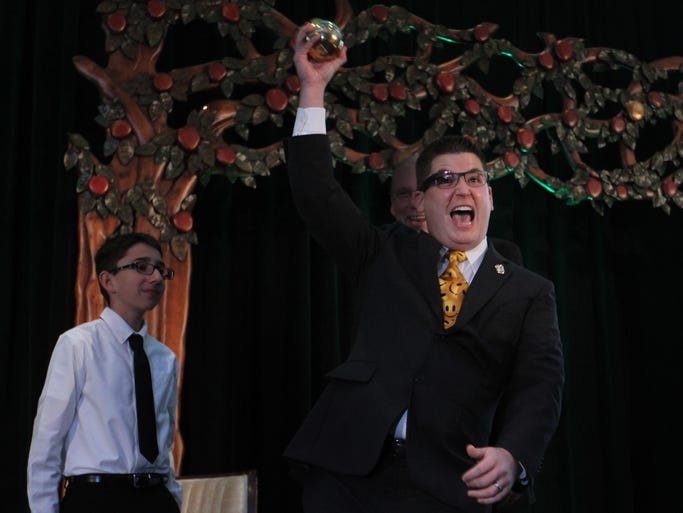 Adam Winkle, of Mike Davis Elementary School, celebrates as he receives his golden apple award during the 24th annual Champions for Learning Golden Apple Celebration of Teachers Dinner at The Naples Beach Hotel & Golf Club on Friday night. Recipients of the awards were Frederick Rimmler II, of Immokalee High School, Ryan Shore of Pelican Marsh Elementary School, Suzanne Szczepanski, of Lely High School, Jacqueline Williams, of Lely High School, and Adam Winkle of Mike Davis Elementary School.