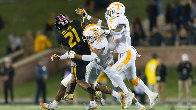 Missouri running back Ish Witter (21) is met by the Tennessee defense during a game between Tennessee and Missouri at Faurot Field in Columbia, Missouri, on Saturday November 11, 2017.