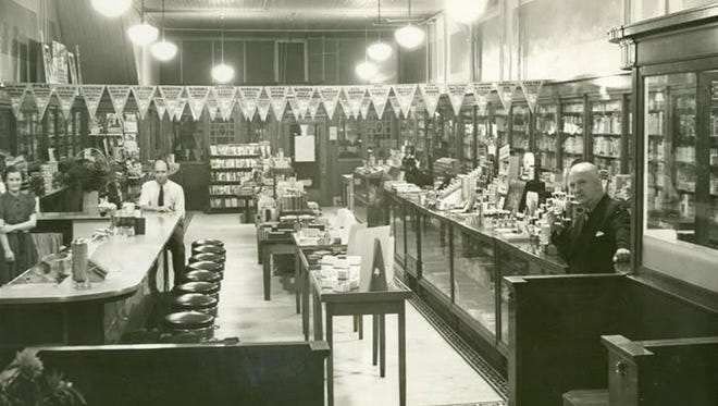 """Clark Bassett, far right, inside his Bassett's Drugstore in Sturgeon Bay in an undated photo. Mary Grota and Ginny Haen give a program on """"Sturgeon Bay Drugstores of the Past""""Oct. 23 for the Door County Historical Society."""