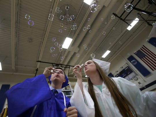 Grant Anderla and Kaitlyn Sawin have fun blowing bubbles