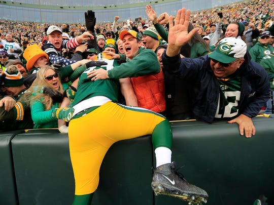 Green Bay Packers defensive end Dean Lowry does a Lambeau Leap after scoring a touchdown against the Tampa Bay Buccaneers in the second quarter at Lambeau Field on Sunday.