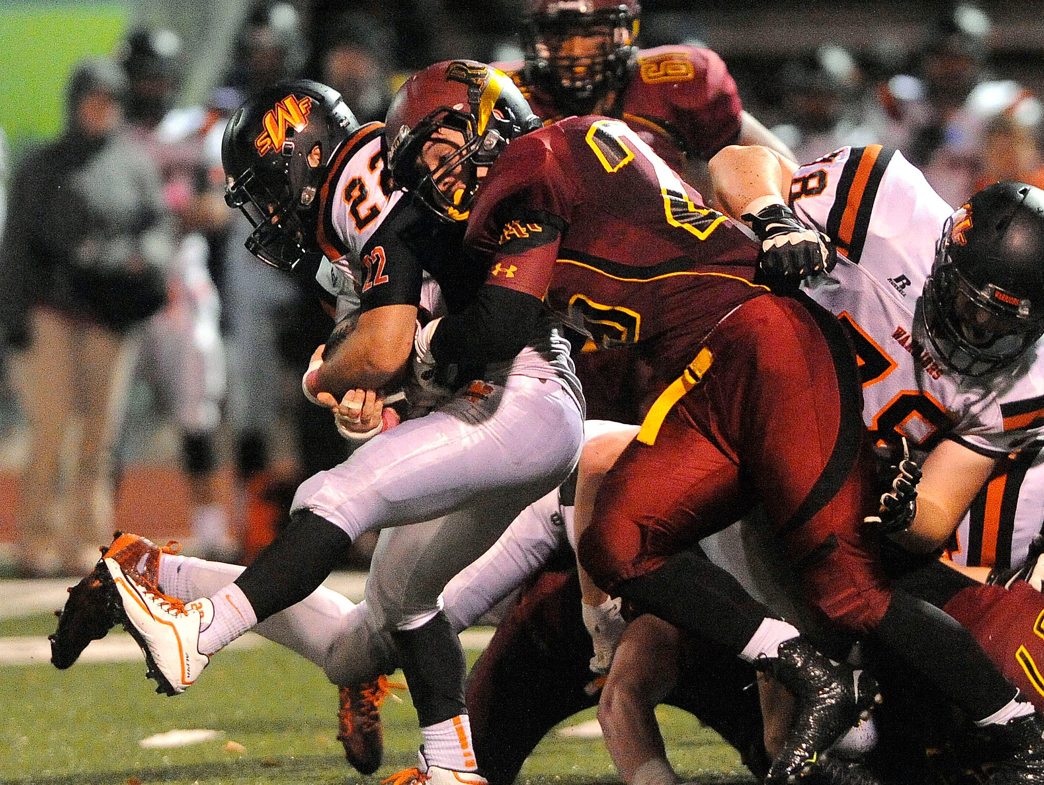 Washington's #22 Chayden Fitzsimmons is tackled by Roosevelt's #25 Tanner Machacek during football action at Howard Wood Field in Sioux Falls, S.D., Thursday, Oct. 22, 2015.